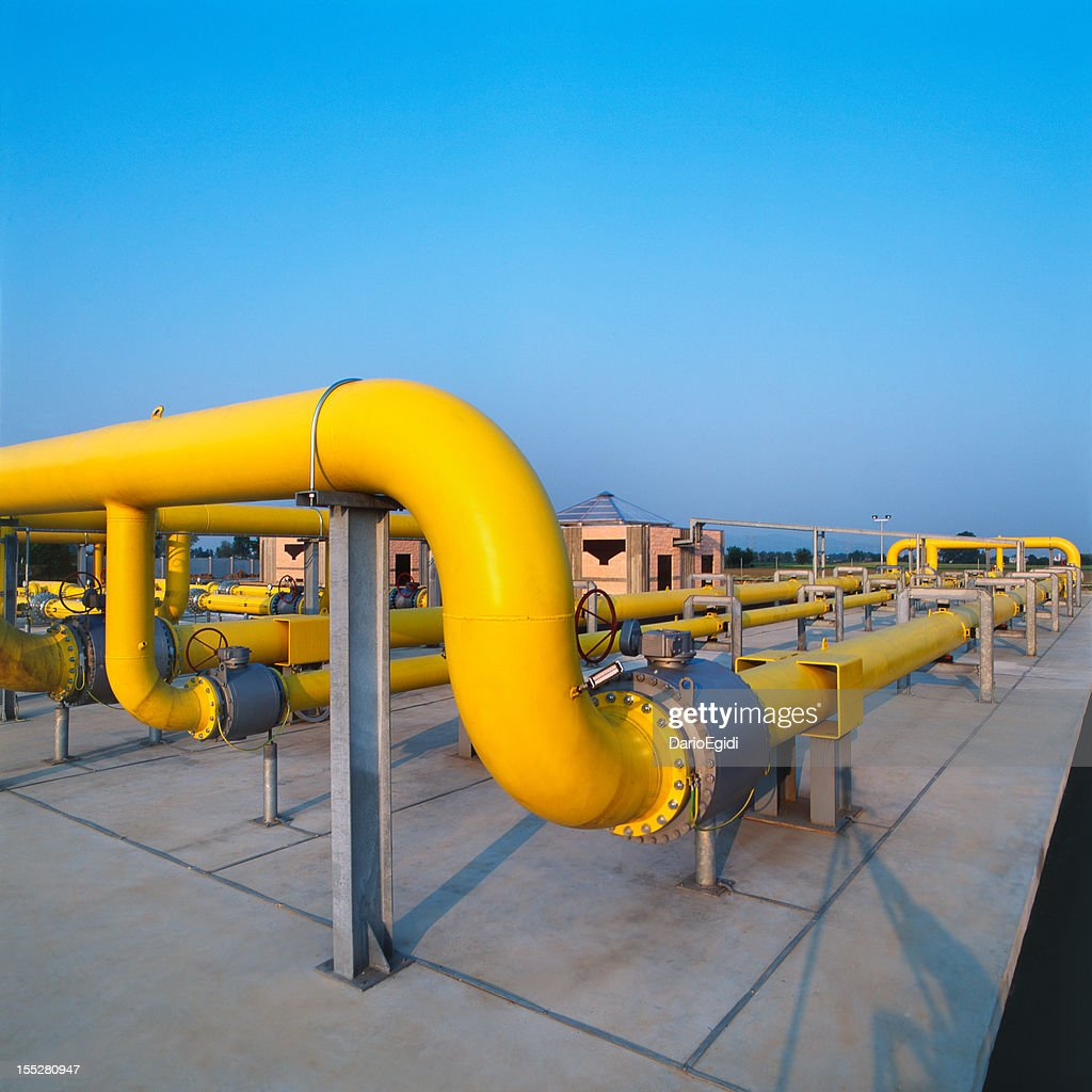 Yellow pipes in a gas distribution station, blue sky background : Stock Photo