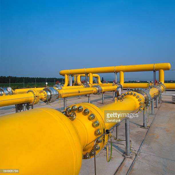 Yellow pipes in gas distribution station, blue sky on background
