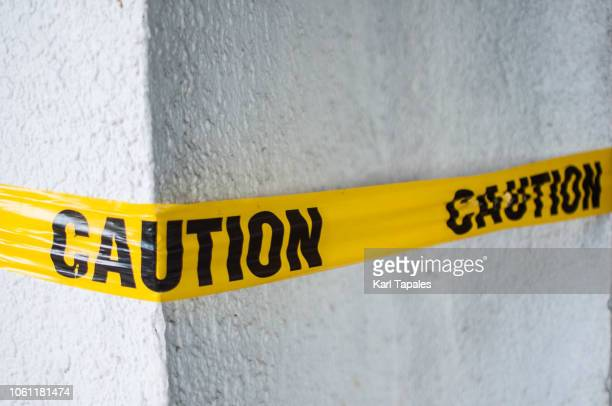 a yellow plastic cordon tape caution warning sign - cordon boundary stock pictures, royalty-free photos & images