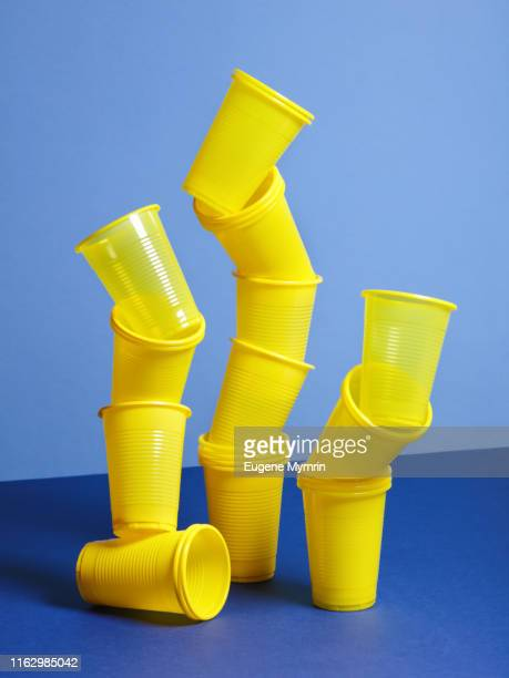 yellow plastic cups - collection stock pictures, royalty-free photos & images