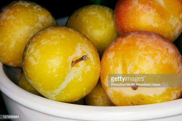 Yellow plums in bowl