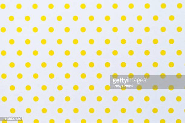 yellow polka dots - spotted stock pictures, royalty-free photos & images