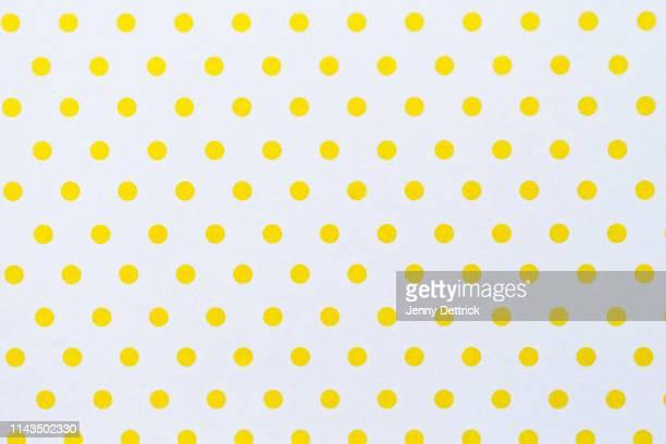 yellow polka dots - spotted stock-fotos und bilder