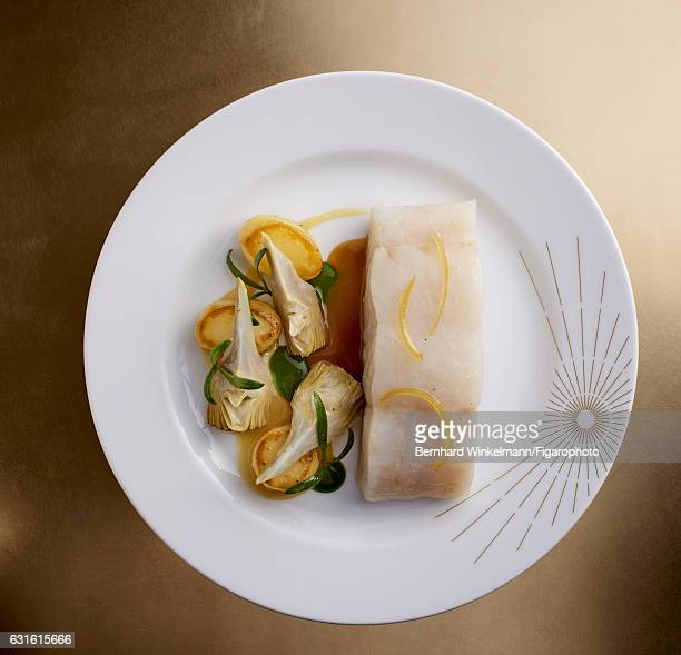 Yellow pollock artichokes and potatoes are photographed for Madame Figaro on November 25 2016 in Versailles France From Alain Ducasse's Ore the...