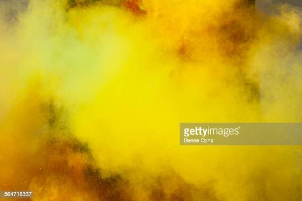yellow powder paint spraying during holi festival - holi stock pictures, royalty-free photos & images