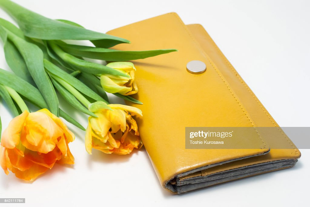 Yellow purse and tulip : Stock Photo