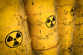 Yellow radioactive waste barrels - nuclear waste dumping concept
