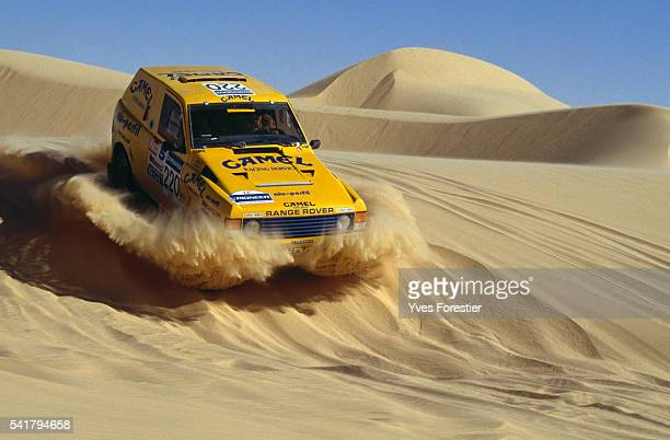 A yellow Range Rover car goes through the Niger desert during the N'Gourti Dirkhou leg of the 12th ParisDakar rally | Location Between Dirkhou and...