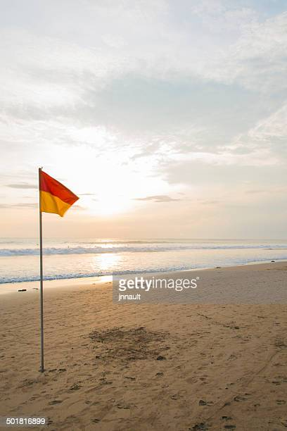 Yellow & Red Flag on beach.