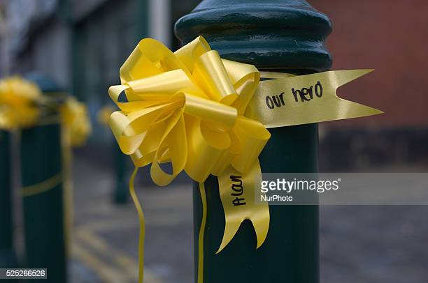 A yellow ribbon adorning a piece of street furniture The writing says 'Alan our hero' on October 5 2014 in Salford England A video purporting to show...