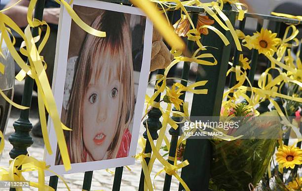 Yellow ribbon candles and a picture of Madelaine McCann are seen on the railings outside the reception of the Ocean Club in Praia da Luz Portugal 12...