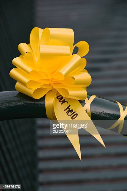 A yellow ribbon for murdered British hostage Alan Henning is seen in the town centre of Eccles north west England on October 5 2014 Britain united in...