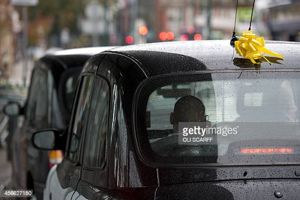 A yellow ribbon for murdered British hostage Alan Henning is tied to a taxi seen in the town centre of Eccles north west England on October 4 2014...