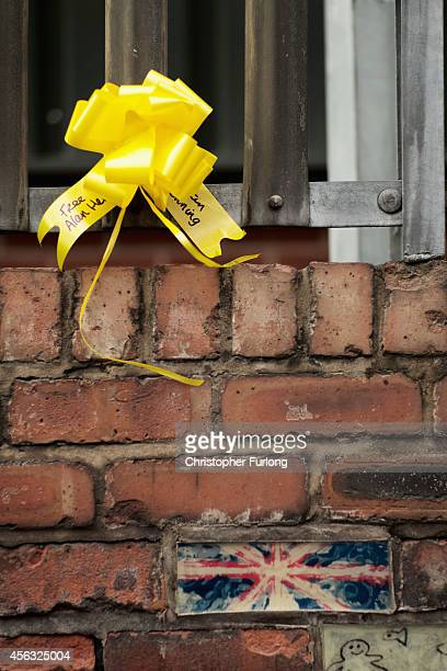A yellow ribbon is tied to a fence in support of Islamic State hostage Alan Henning on September 29 2014 in Salford England Neighbours of hostage...