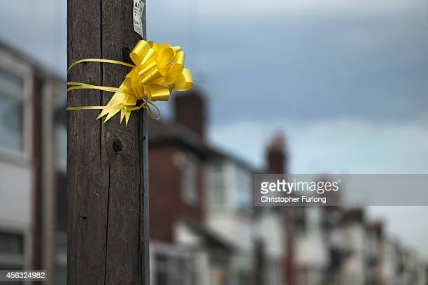 A yellow ribbon is tied to a post in support of Islamic State hostage Alan Henning on September 29 2014 in Salford England Neighbours of hostage Alan...
