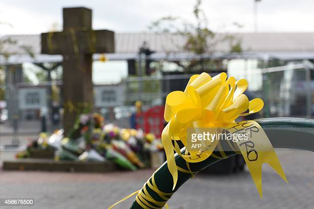 Yellow ribbons adorn Eccles town centre for murdered aid worker Alan Henning in Eccles north west England on October 5 2014 Britain united in...