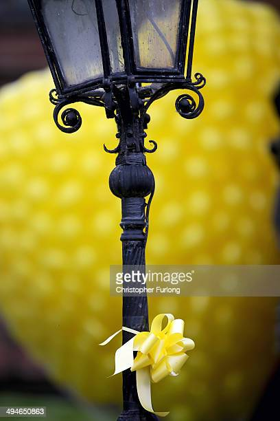 Yellow ribbons adorn the street during the funeral service of teenage cancer fundraiser Stephen Sutton outside Lichfield Cathedral on May 30 2014 in...