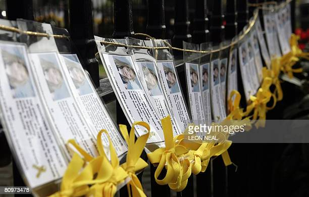 Yellow ribbons and messages are tied to a fence in the village of Rothley Leicestershire on the day of the first anniversary since the disappearance...