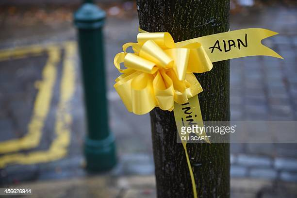 Yellow ribbons for murdered British hostage Alan Henning are attached to trees in the town centre of Eccles north west England on October 4 2014...