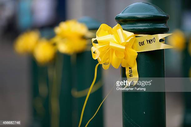 Yellow ribbons with 'Our Hero' written on them now cover Eccles town centre in memory of murdered British aid worker Alan Henning on October 5 2014...