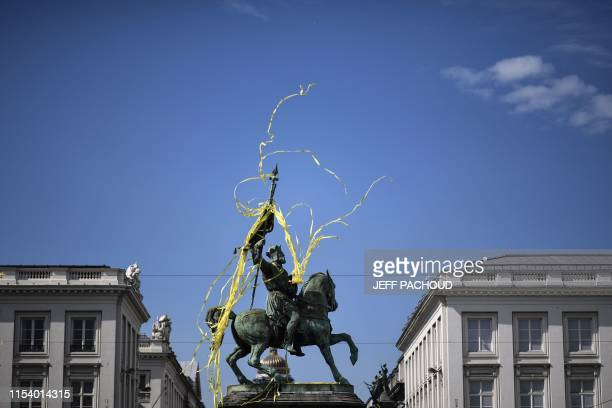 Yellow ribbons wrapping the statue of Godefroy de Bouillon fly at the Place Royale - Koningsplein Square before the start of the first stage of the...