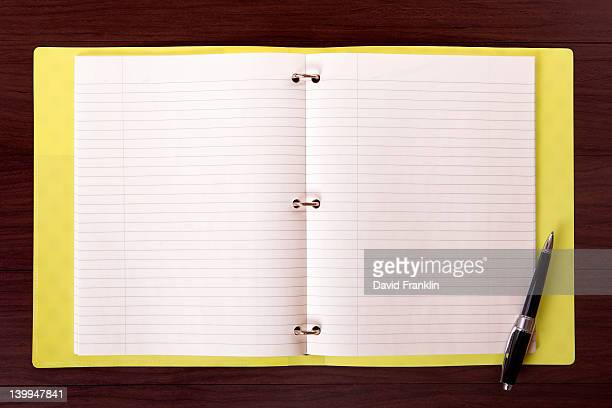 Yellow ring binder with copyspace.