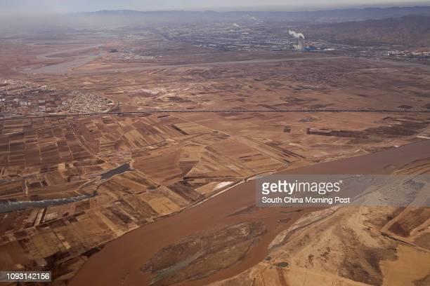 Yellow River runs pass Baotou city, Inner Mongolia, on Nov. 17, 2017. The metro construction in Baotou city has been suspended after Yu Zhengzheng,...