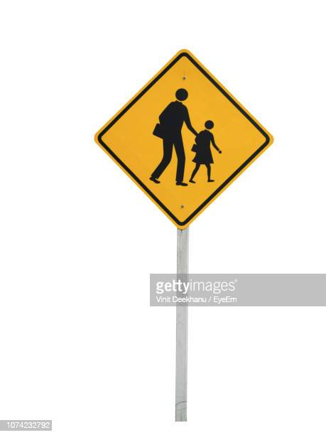 yellow road sign against white background - crossing sign stock pictures, royalty-free photos & images