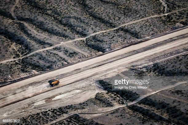 yellow rock truck - rock object photos et images de collection