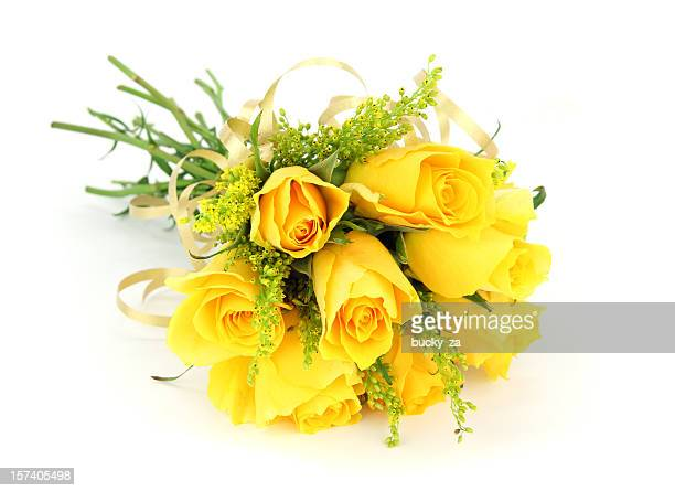 Yellow rose bouquet isolated on white with ribbon