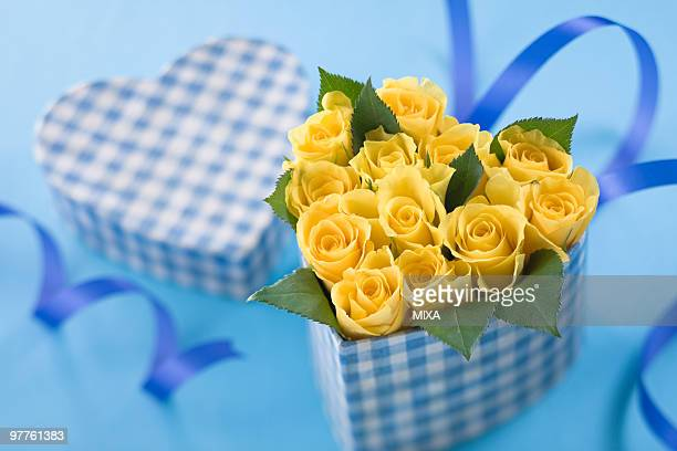 Yellow rose in heart shaped box