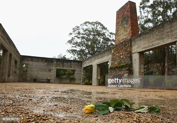A yellow rose is seen in what once was the Broad Arrow Cafe during the 20th anniversary commemoration service of the Port Arthur massacre on April 28...