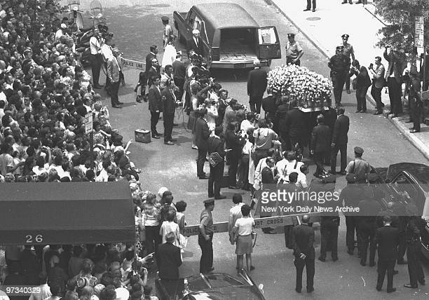 Yellow roses cover Judy Garland's coffin as it is taken to hearse at Campbell Funeral Home