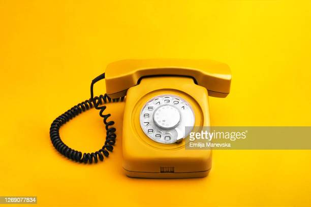 yellow rotary phone - the past stock pictures, royalty-free photos & images