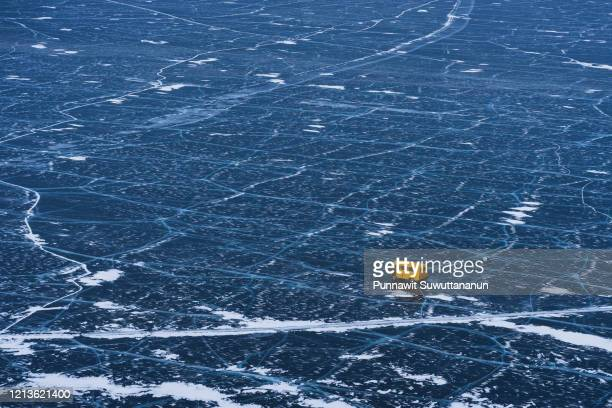 yellow russian van driving on baikal frozen lake in winter season, siberia, russia - シベリア ストックフォトと画像