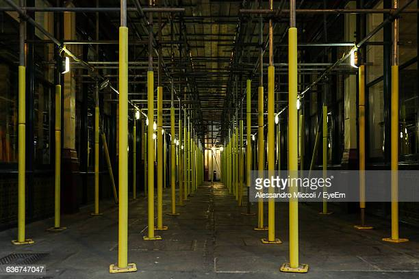 yellow scaffoldings in building - alessandro miccoli stock photos and pictures