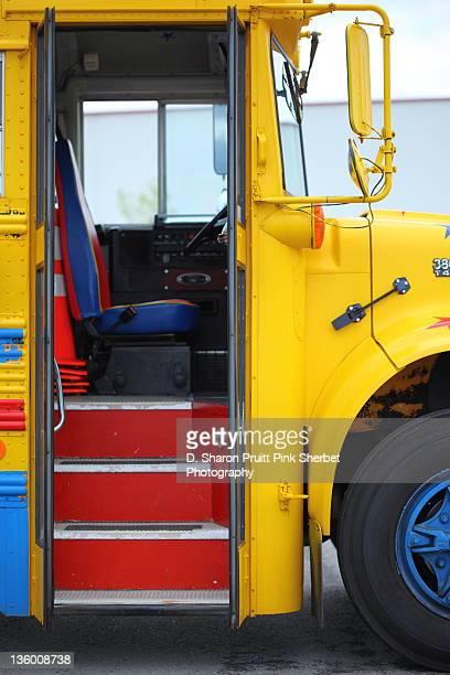 Yellow school bus with open entry door