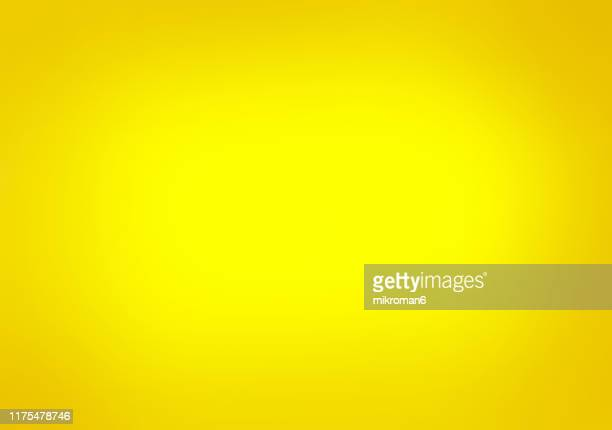 yellow shaded paper background - gelb stock-fotos und bilder