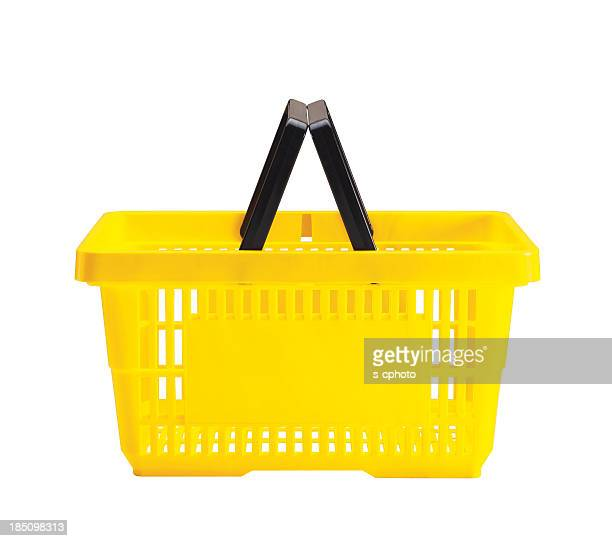 a yellow shopping basket with a black handle - basket stock photos and pictures