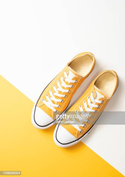 yellow sneakers - still life stock pictures, royalty-free photos & images