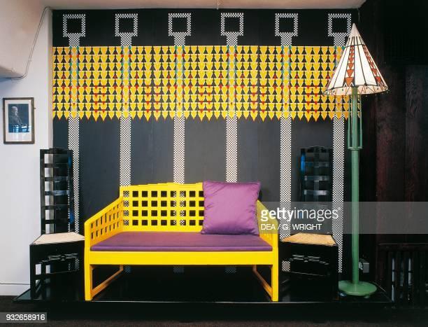 Yellow sofa chairs lamp and wallpaper by Charles Rennie Mackintosh United Kingdom 20th century