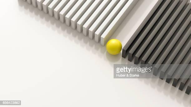 yellow sphere between black cubes