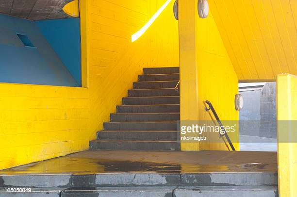 Yellow staircase in London with bright sunbeam