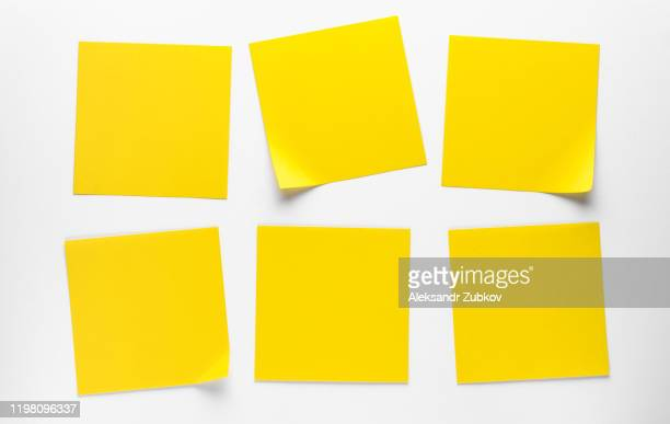 yellow sticky stickers on a white background to remind you of information. space for text. - メモ ストックフォトと画像