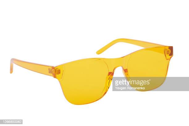 yellow sunglasses isolated on a white background - sunglasses stock pictures, royalty-free photos & images