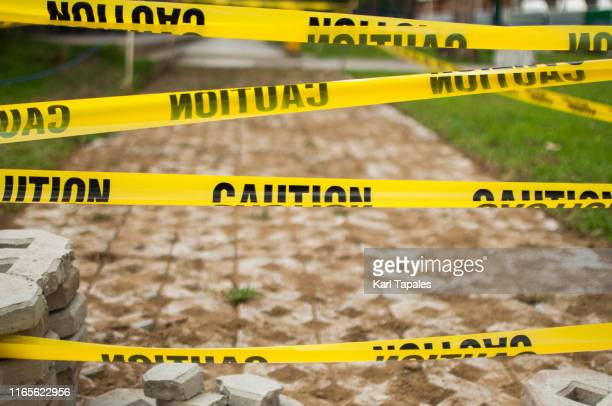 yellow tape caution sign outdoor during day time - cordon tape stock pictures, royalty-free photos & images