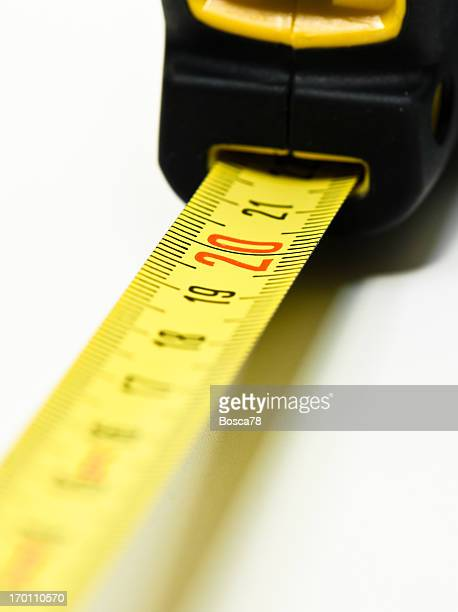 yellow tape measure meter - inch stock pictures, royalty-free photos & images