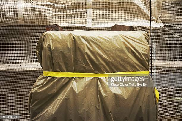 Yellow Tape Tied To Package Against Window