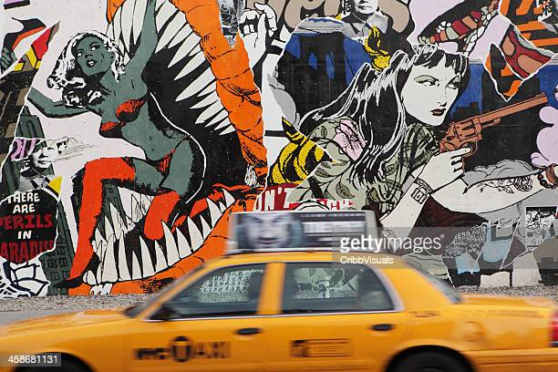 NYC yellow taxi and mural wall on Houston Street
