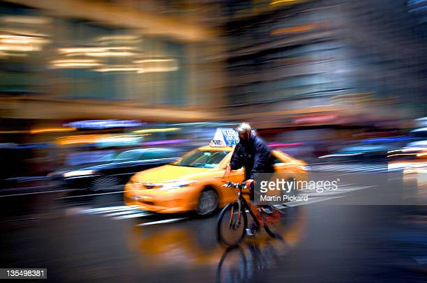 yellow taxi cab and cycle on street - ニューヨーク郡 ストックフォトと画像